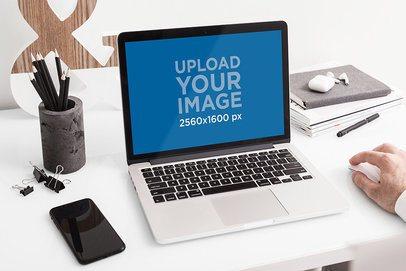 MacBook Pro Mockup Featuring an Elegant Desk 483-el