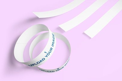 Mockup of Multiple Paper Wristbands Lying on a Solid Color Surface 639-el