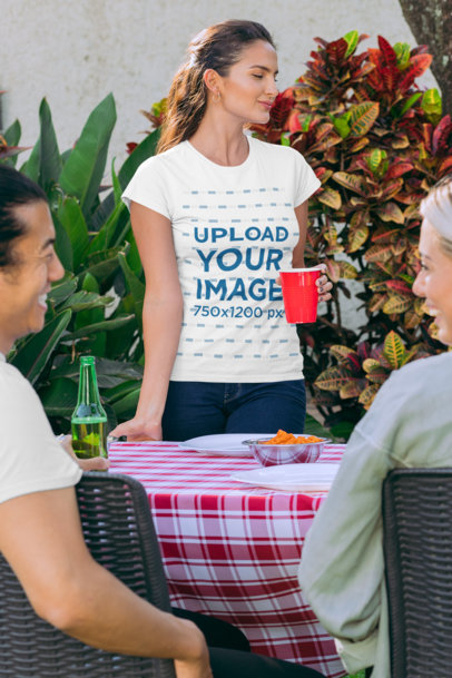 T-Shirt Mockup Featuring a Woman Drinking from a Red Cup at a BBQ Party 29705