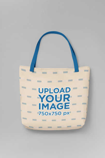 Mockup of a Tote Bag with Customizable Strap Placed Over a Colored Surface 29606