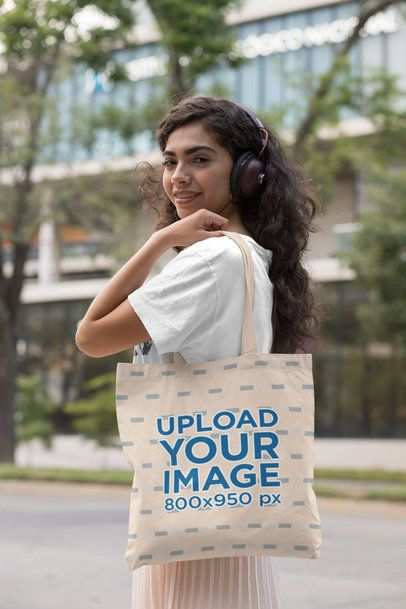 Tote Bag Mockup of a Woman with Headphones in the City 29453