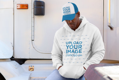 Pullover Hoodie Mockup of a Man with a Trucker Hat 29464
