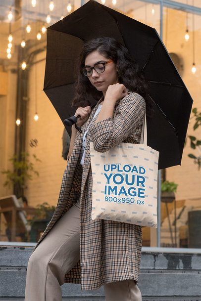 Mockup of a Fancy Woman Carrying a Tote Bag on a Rainy Afternoon 29456