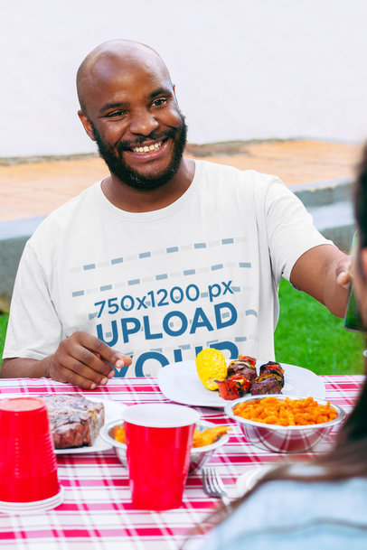 Mockup of a Bald Man Wearing a Crewneck T-Shirt at a BBQ Party 29714
