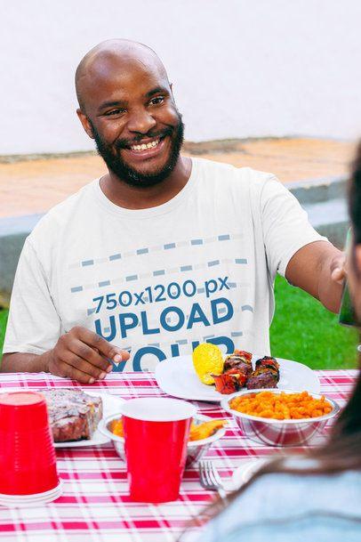 Mockup of a Bald Man Wearing a Crewneck T-Shirt at a BBQ Party 29714