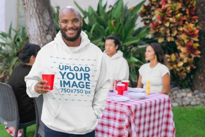 Pullover Hoodie Mockup of a Man at a BBQ Party 29711