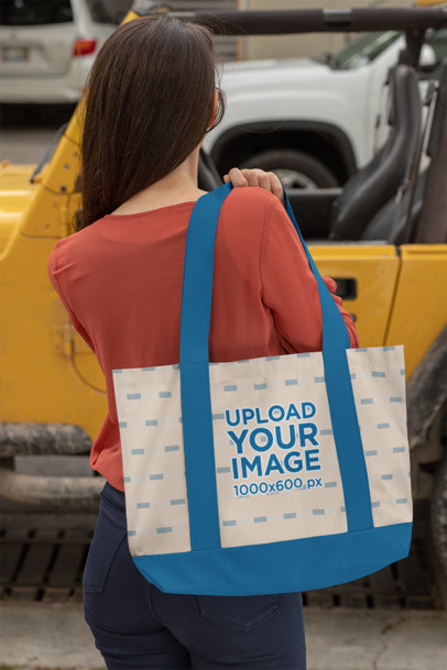 Mockup of a Woman Carrying a Weekend Tote Bag by a Jeep 29794