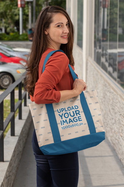 Mockup of a Smiling Woman Holding a Weekend Bag 29795