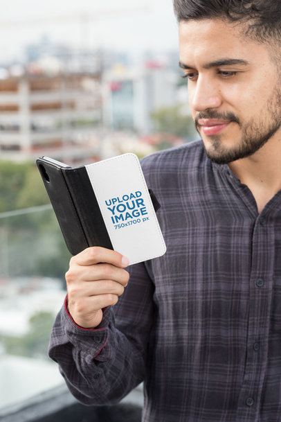 Wallet Case Mockup of a Man Looking at His iPhone 11 29821