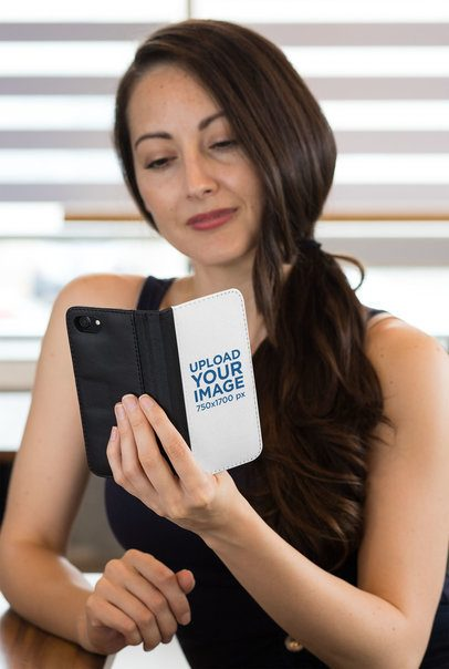Mockup of a Woman with Long Hair Holding a Wallet Case for iPhone 29812