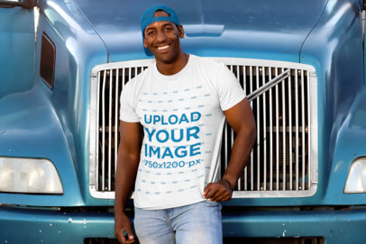 T-Shirt Mockup of a Man Leaning Against a Blue Truck 29477