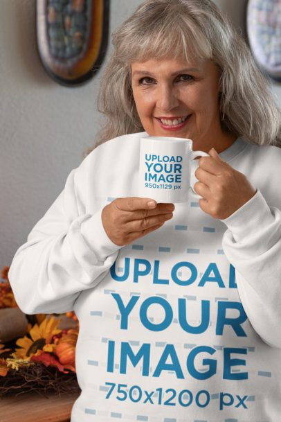 Mockup of an Elderly Woman with a Sweatshirt Sipping from an 11 oz Coffee Mug 29936