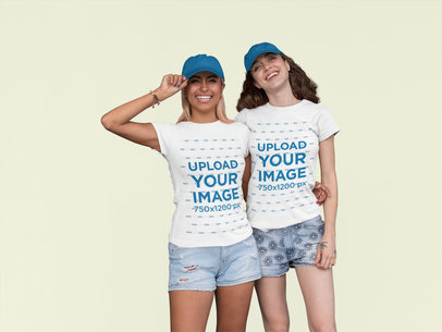 Mockup of Two Friends Wearing Matching T-Shirts at a Studio 29624