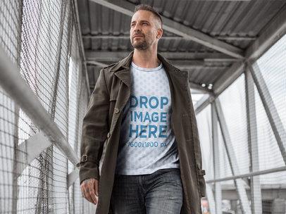 T-Shirt Mockup of a Tattooed Man in a Pedestrian Bridge a9357