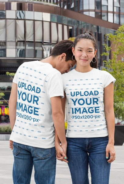 Mockup of a Couple Wearing T-Shirts in the City 29762