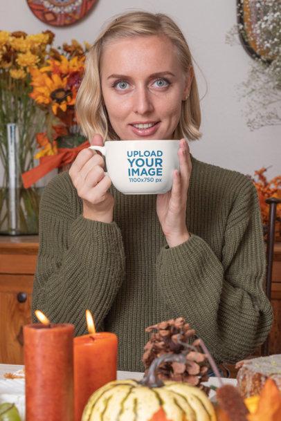 24 oz Coffee Mug Mockup Featuring a Woman at a Thanksgiving-Set Table 29940