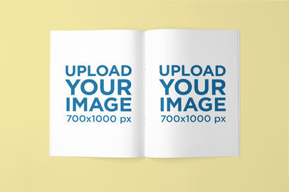 Mockup Featuring an Open Magazine Lying Against a Plain Backdrop 763-el