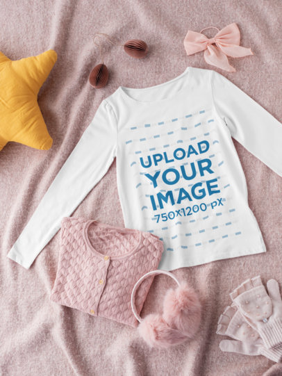 Mockup of a Long Sleeve Tee for a Girl Lying on a Textured Surface 29771
