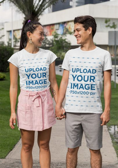 Mockup of a Young Couple With Customizable T-Shirts Holding Hands 29769