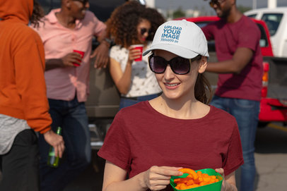 Mockup of a Woman at a Tailgate Party Wearing an Embroidered Dad Hat 29879