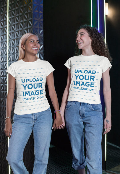 Mockup of Two Friends Wearing Matching Tees and Holding Hands 29627