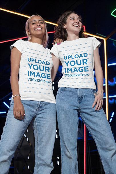 Mockup of Two Friends Wearing Matching Crewneck T-Shirts at an Arcade 29631