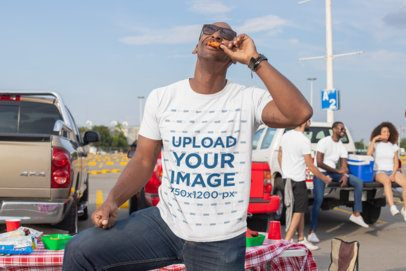T-Shirt Mockup of a Man Eating at a Tailgate Party 29889