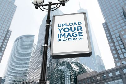 Advertising MUPI Mockup Placed on a Lamp Post Against City Buildings 452-el