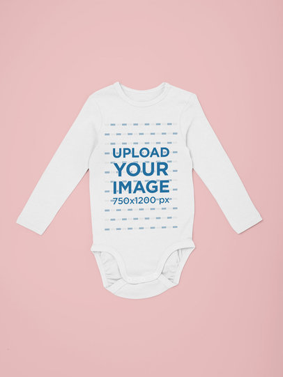 Mockup of a Long Sleeve Onesie Over a Colored Background 29831