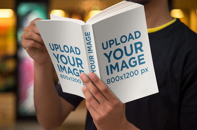 Book Cover Mockup Featuring a Man Reading a Digest Size Book 868-el