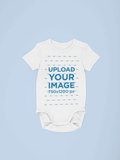 Mockup of a Onesie Placed Against a Flat Surface 29833
