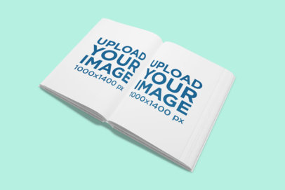 Mockup of an Open Book on a Solid Color Surface 853-el