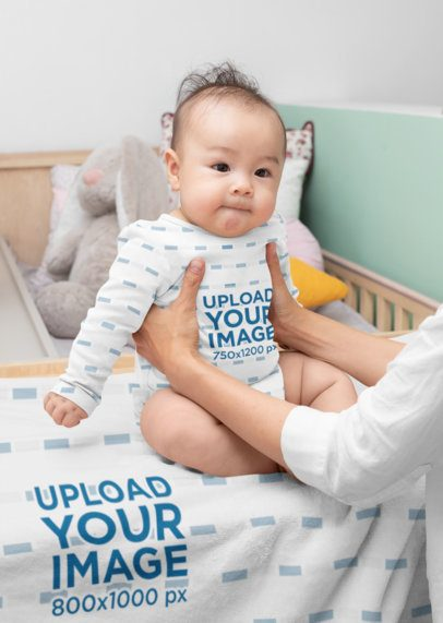 Onesie Mockup of a Baby Boy Sitting on a Blanket 30052