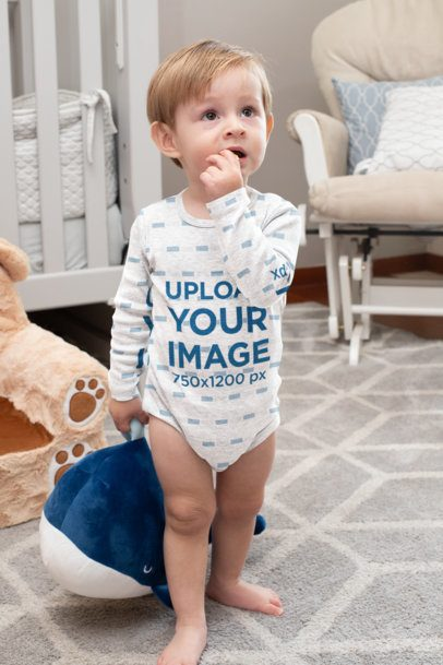Mockup of a Boy in a Long Sleeve Onesie Playing in His Room 29998