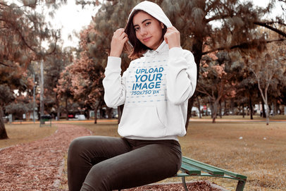 Mockup of a Woman Wearing a Pullover Hoodie at a Park 30117