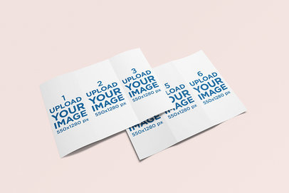 Minimal Mockup Featuring Two Trifold Brochures Lying on a Solid Color Surface 267-el