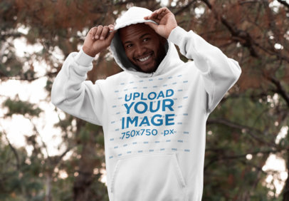 Hoodie Pullover Mockup Featuring a Joyful Man in the Woods 30306