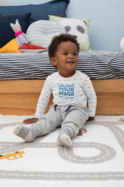 Mockup of a Baby Boy Wearing a Long Sleeve Onesie in His Room 30030
