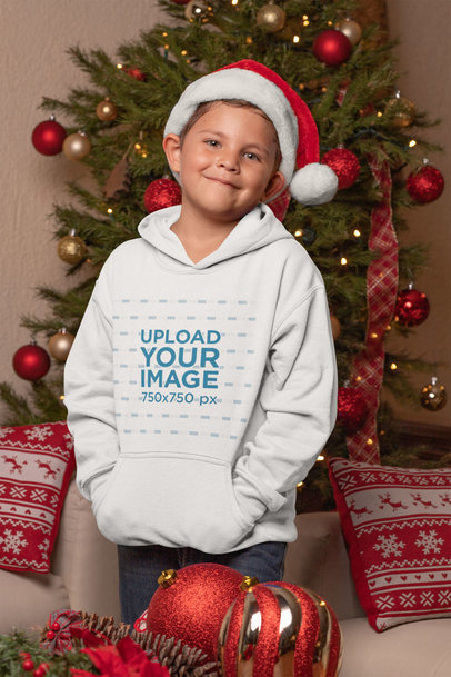 Pullover Hoodie Mockup of a Kid with a Santa Claus Hat on Christmas Day 30191
