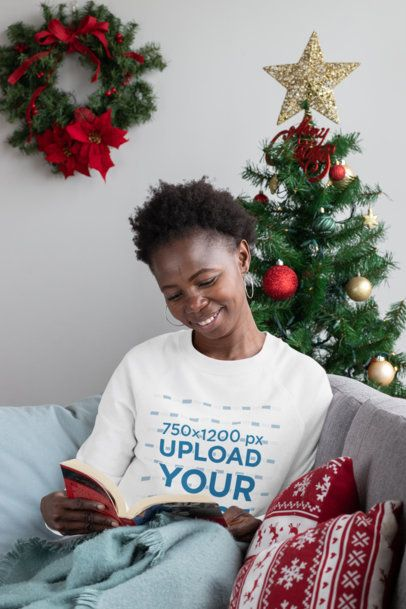 Sweatshirt Mockup of a Happy Woman Reading Next to a Christmas Tree 30349