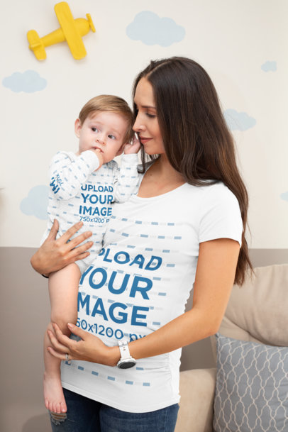 Mockup of a Mom Wearing a Customizable T-Shirt While Holding Her Baby with a Sublimated Onesie 30019