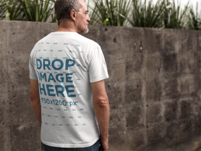 Middle Aged Man Wearing a T-Shirt Mockup from the Back in a Urban Space a10984b