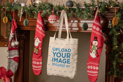 Mockup of a Tote Bag Hanging Between Christmas Stockings 30193