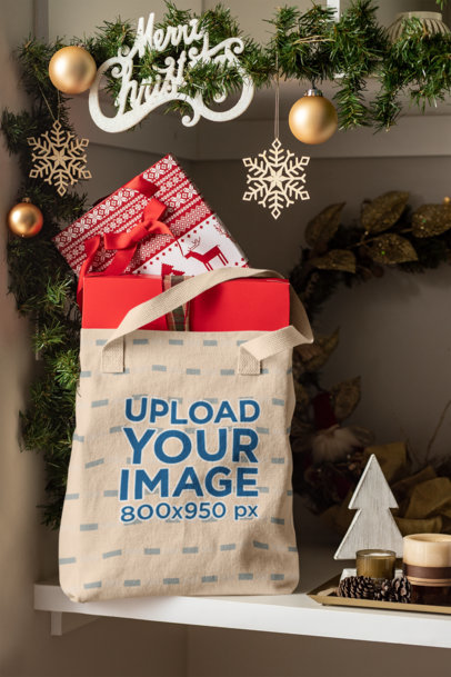 Mockup Featuring a Tote Bag Placed on a Shelf near Some Christmas Decorations 30366