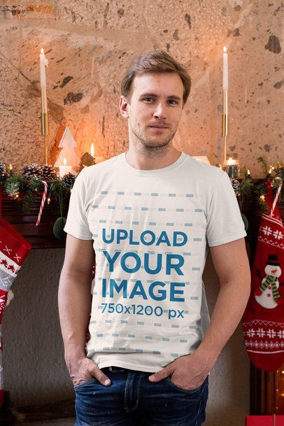 T-Shirt Mockup of a Man in a Cozy Christmas Setting with Candles 30173