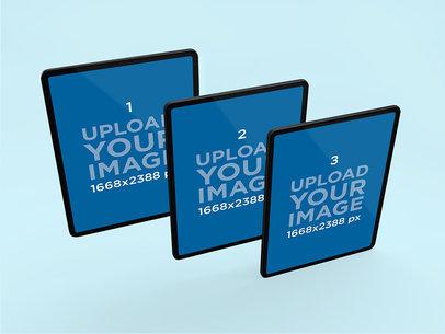 Mockup of Three iPad Pros Floating in Line 1021-el