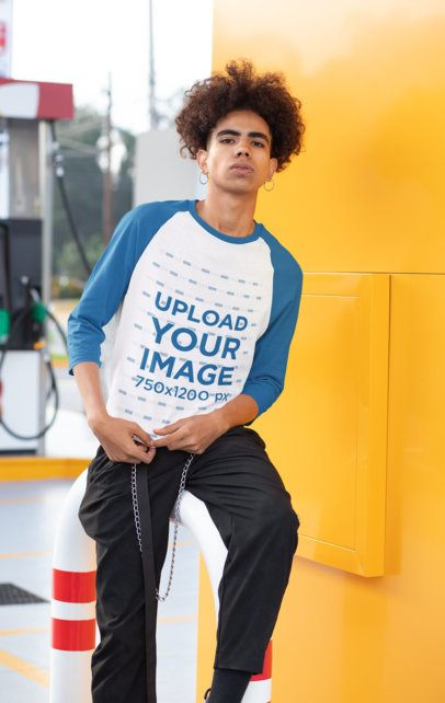 Mockup of a Man in a Gas Station Wearing a Raglan Tee with Tree-Quarter Sleeves 30207