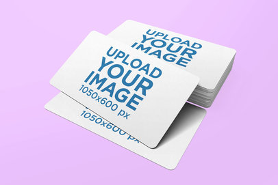 Mockup Featuring a Business Card Stack Against a Solid Color Backdrop 979-el