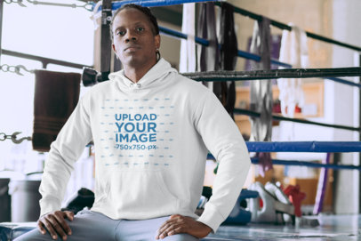 Pullover Hoodie Mockup Featuring a Serious Man Sitting on a Boxing Ring 30164