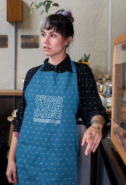 Mockup of a Barista Wearing a Sublimated Apron at a Restaurant 30269